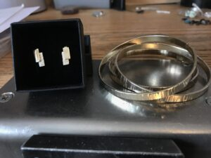 Gold bangle and earrings